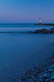 Oakville Lighthouse Evening Light. A view of the Oakville lighthouse from the stoney shore of Lake Ontario in the evening light Stock Photos