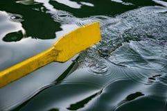 Oar of boat touching water royalty free stock photo