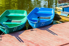 Oar boats and pedal boat Stock Photos