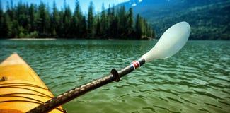 Oar in kayak over lake Stock Photo