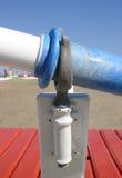 Oar and oarlock on the beach Stock Photo