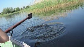 Oar on water Stock Photography