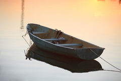 Oared boat on a lake bank Stock Photos