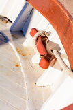 Oarlock and rope on a sailboat. Stock Photos