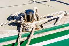 Oarlock and rope on a sailboat. Royalty Free Stock Photos