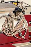 Oarlock and rope on a sailboat. Fragmentary view details of knots and ropes on the yacht moored in the dock Royalty Free Stock Photography