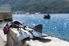 Oars are dried in the sun. The sea Stock Photography