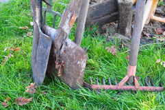 Oars and fork on grass. Oars standing on grass at garden Stock Photos
