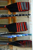 Oars stacked in boat shed Stock Images