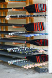 Rowing boat oars stacked in boat shed. Colourful rowing boat oars stacked in boat shed Royalty Free Stock Photos