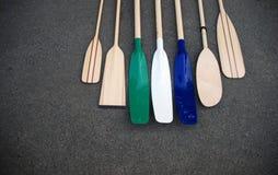 Oars. There are most of oar kinds: Amberlat plastic blade oars, kayak paddles, kanoe paddles, plastic oar blades, rowing boar oars Royalty Free Stock Images