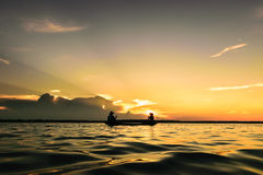 Oarsman. Fisher were ferried back home at sunset Royalty Free Stock Image