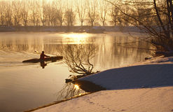 Oarsman on ice cold lake Royalty Free Stock Images