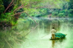 Oarsman on nongchangkod River, Chiangrai, Thailand Stock Photo