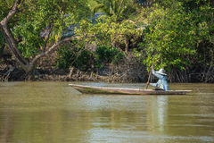 Oarsman on the river, Thailand. Royalty Free Stock Photography