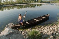 Oarsman on river Ticino Royalty Free Stock Photos