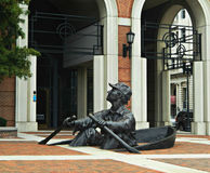 The Oarsman Sculpture Knoxville, Tennessee. The Oarsman a whimsical sculpture of a man in a row boat, half sunk into the brick sidewalk, was created by David L Royalty Free Stock Photos