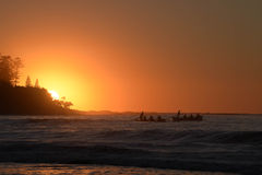 Oarsmen at dawn Royalty Free Stock Photography