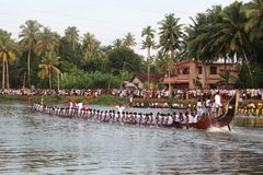 Oarsmen of a snake boat team. Row aggressively in the Pumba Boat race on September 09, 2011 in Thiruvalla, Kerala, India Royalty Free Stock Image