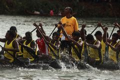 Oarsmen of a snake boat team. Row aggressively in the Pumba Boat race on September 09, 2011 in Thiruvalla, Kerala, India Stock Photo