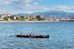 Oarsmen training. GETXO, SPAIN - AUGUST 10: Oarsmen training to participate in a rowing race on August 10, 2013 in Getxo, Spain. Rowing races is a typical sport Stock Photography