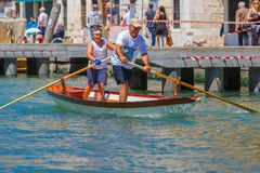 Oarsmen in the Venice Vogalonga regatta, Italy. Royalty Free Stock Images