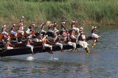 Oarsmen wearing traditional kerala dress row thier snake boat in the Aranmula boat race Royalty Free Stock Photos