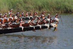 Oarsmen wearing traditional kerala dress row thier snake boat in the Aranmula boat race. Unidentified oarsmen wearing traditional kerala dress row thier snake Stock Photo
