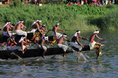 Oarsmen wearing traditional kerala dress row thier snake boat in the Aranmula boat race. Unidentified oarsmen wearing traditional kerala dress row thier snake Royalty Free Stock Image