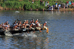 Oarsmen wearing traditional kerala dress row thier snake boat in the Aranmula boat race. Unidentified oarsmen wearing traditional kerala dress row thier snake Royalty Free Stock Photography