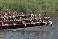 Oarsmen wearing traditional kerala dress row thier snake boat in the Aranmula boat race Royalty Free Stock Photo