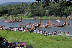 Oarsmen wearing traditional kerala dress row thier snake boat in the Aranmula boat race Royalty Free Stock Photography