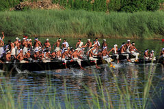Oarsmen wearing traditional kerala dress row thier snake boat in the Aranmula boat race Royalty Free Stock Photos