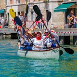 Oarsmen welcome viewers in Venice Vogalonga. Stock Image