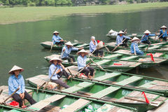 Oarswomen Waiting for Tourists. Oarswomen sitting in their boats and waiting for the tourists to come back from a local pagoda. They give tourists a ride, which Stock Image