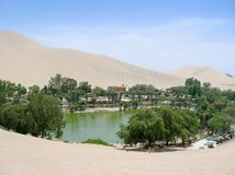 Oasis in the desert of Peru lagoon royalty free stock images