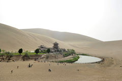 An Oasis in the desert. Singing Sands Mountain of China Stock Image