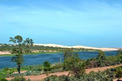 Oasis lagoon and white sand dunes. stock photo
