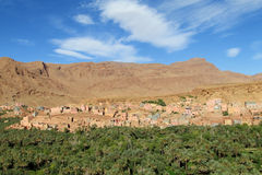 Oasis river valley in dry desert in north Africa stock images