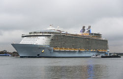 Oasis of the seas. The oasis of the seas leaving the rotterdam harbor to southampton on Okt 2014 in Rotterdam,this is the biggest cruise ship in the world Royalty Free Stock Image