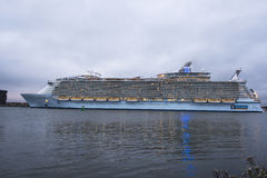Oasis of the seas. The oasis of the seas leaving the rotterdam harbor to southampton on Okt 2014 in Rotterdam,this is the biggest cruise ship in the world Royalty Free Stock Photo