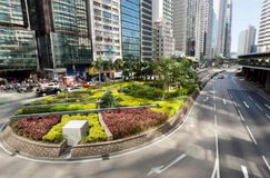 Oasis with trees between urban scyscrapers of glass and concrete in a giant Hong Kong Royalty Free Stock Photo