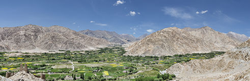 Oasis village in dessert mountains panorama royalty free stock images