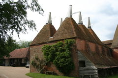 Oast House 3. Old Kentish Oasthouse from the side with barn behind stock photos