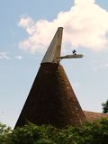 Oast House. Details of the roof of an english oast house weather vane Stock Photo