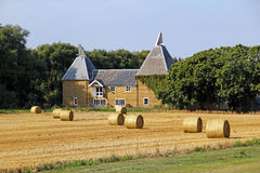 Oast house and hay bales Stock Photos