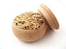 Oat. In wooden pot over white background Stock Photo