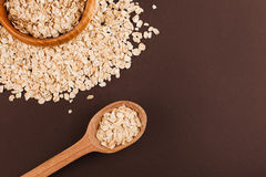 Oat background. Wooden bowl of oat with wooden spoon Royalty Free Stock Photography