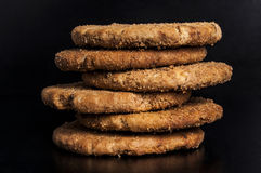 Oat biscuits. Fresh and tasty oat biscuits on black background Royalty Free Stock Photography
