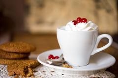 Oat biscuits with coffee and whipped cream Royalty Free Stock Photos